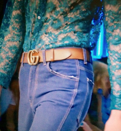 Heritage Gucci logo belt worn in tobacco with a teal lace shirt & 70s wash denim flares