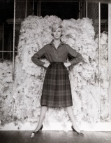 Henry Talbot. No title (Fashion illustration, model Janice Wakely standing in front of wool bale) 1961–66
