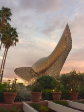 The sculpture outside Hotel Arts resembled a huge golden wedge shoe from this angle.