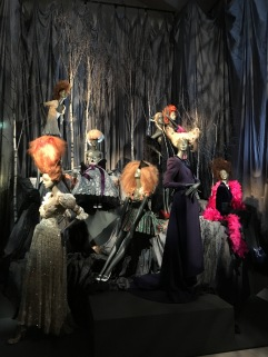 A dramatic mannequin display sets the tone