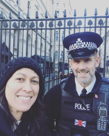 Upholding tradition: Getting a photo with the police force, no matter where I go. Downing Street.