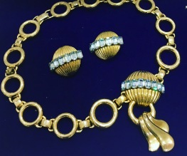 Deco demi parure 1940s signed Schiaparelli decadence. Yes, it's for sale.