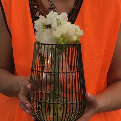 Pretty touches from Flowers Vasette were added to wire candle holders for table settings.
