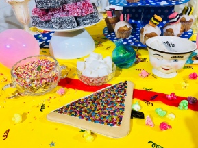 The table setting was a mad dash of colour, quirky face, sprinkles and my fairy bread clutch purse.