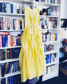 A Benjamin Garg dress in sunshine yellow hangs in the library at my home.