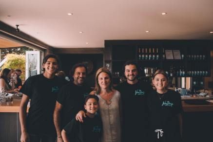 Christian (second from right) with his family, who run the winery, holiday villas and Mornington Peninsula Glamping.