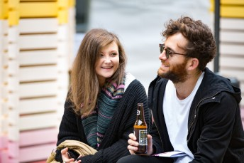 Visitors drinking beer in the courtyard at Immigration Museum during Brew Fest